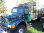 1999 International 4700 T4445 Single Axle Steel Deck Flatbed Truck with Equipment Rack,