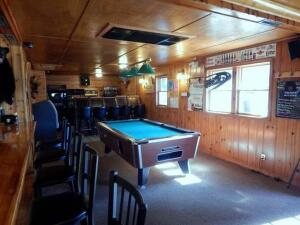 The Rustic Roadhaus is a Turn-Key Business!!! Large dining area, lengthy bar, outdoor courtyard!!
